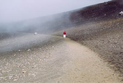 photograph of woman walking along a path